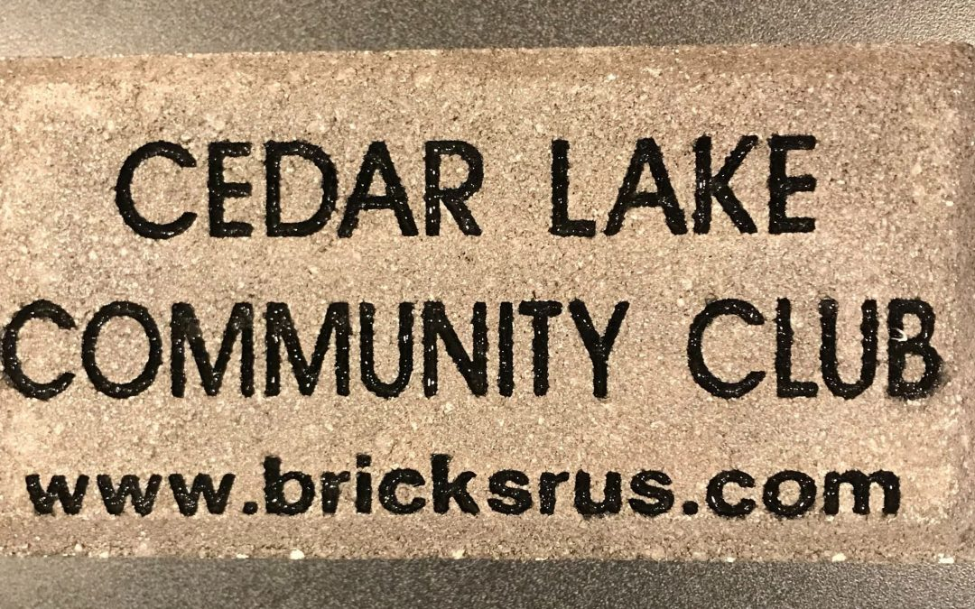 Paver brick with Cedar Lake Community Club engraved on it.
